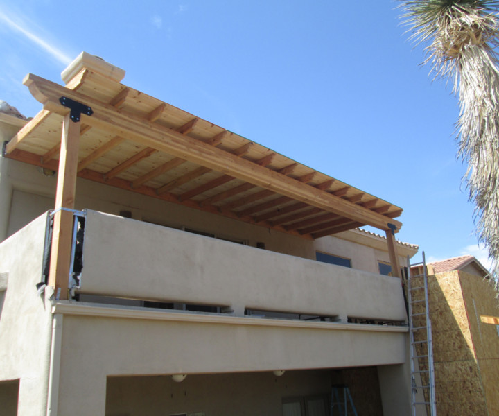 Pergola style roof that will provide shade, protection and more style to the deck and outdoor living space