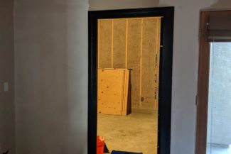 The doorway in this photo is the entry for the new storage room