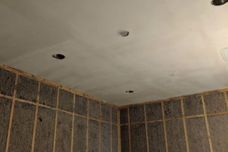 Drywall installed on the ceiling, almost ready for texture.