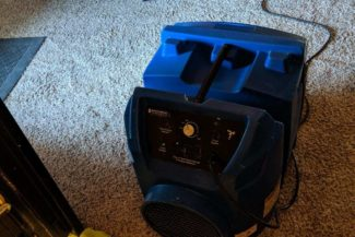 This HEPA air scrubber cleans the lingering insulation particles. We utilize these on job sites regularly to clean the air after sanding drywall.